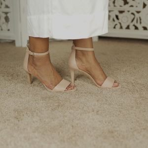 VINCE CAMUTO Nude faux leather open toe heels.